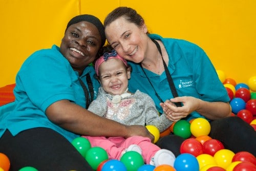 Mira and two nurses smiling ball pool